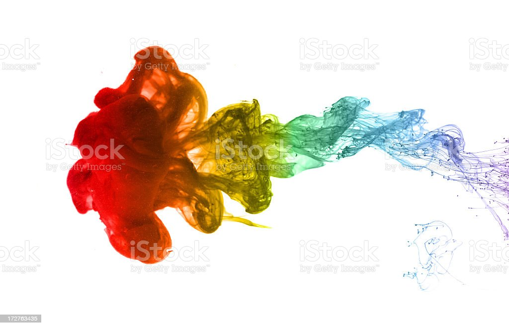 Splash of rainbow-colored ink drops stock photo