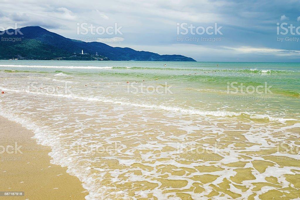 Splash of water at China Beach in Danang in Vietnam stock photo