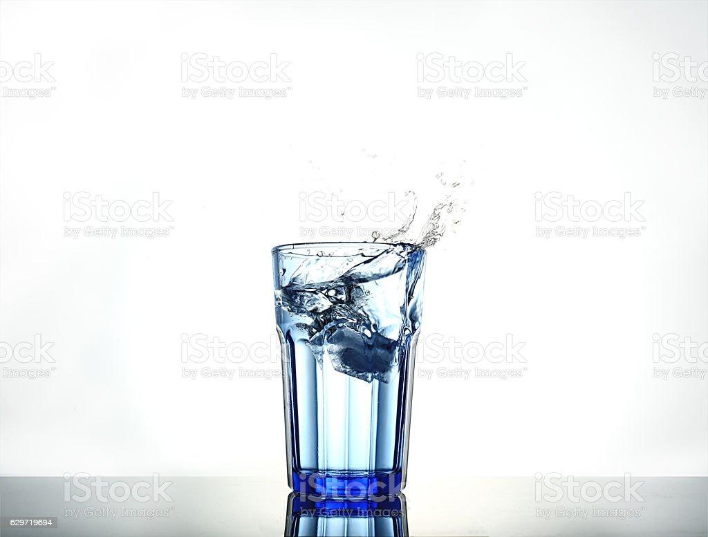 Splash of water with ice stock photo