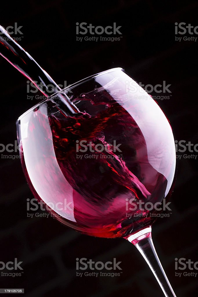 Splash red wine against a black background royalty-free stock photo