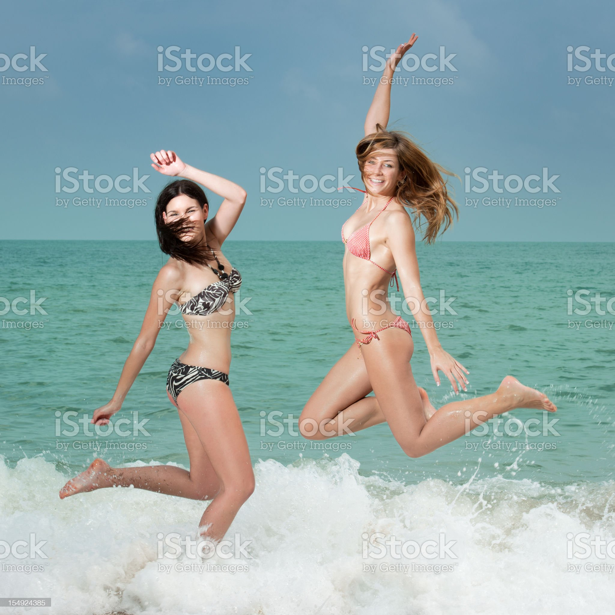 Splash! - Two Beauties splashing through the waves (XXXL) royalty-free stock photo