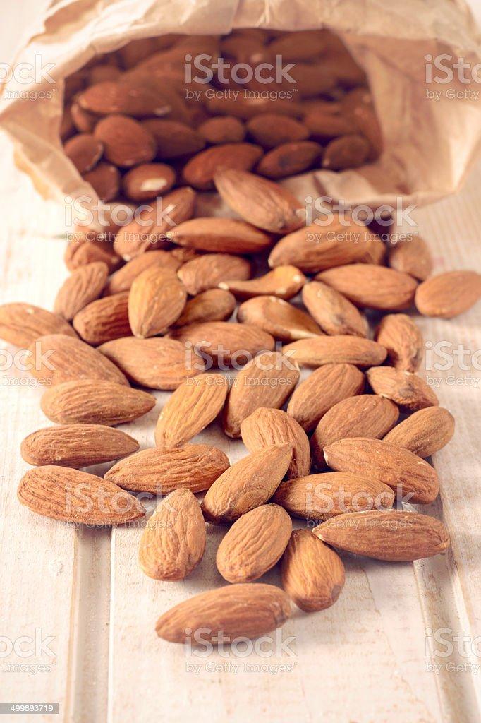Splashed almonds stock photo