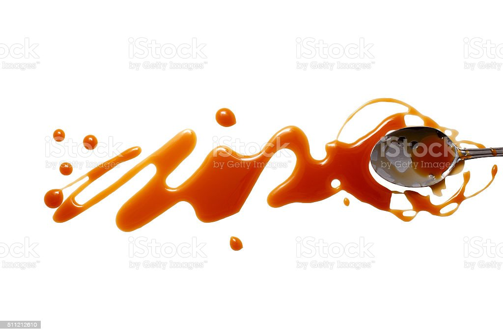 splashes and spilled caramel with a spoon stock photo