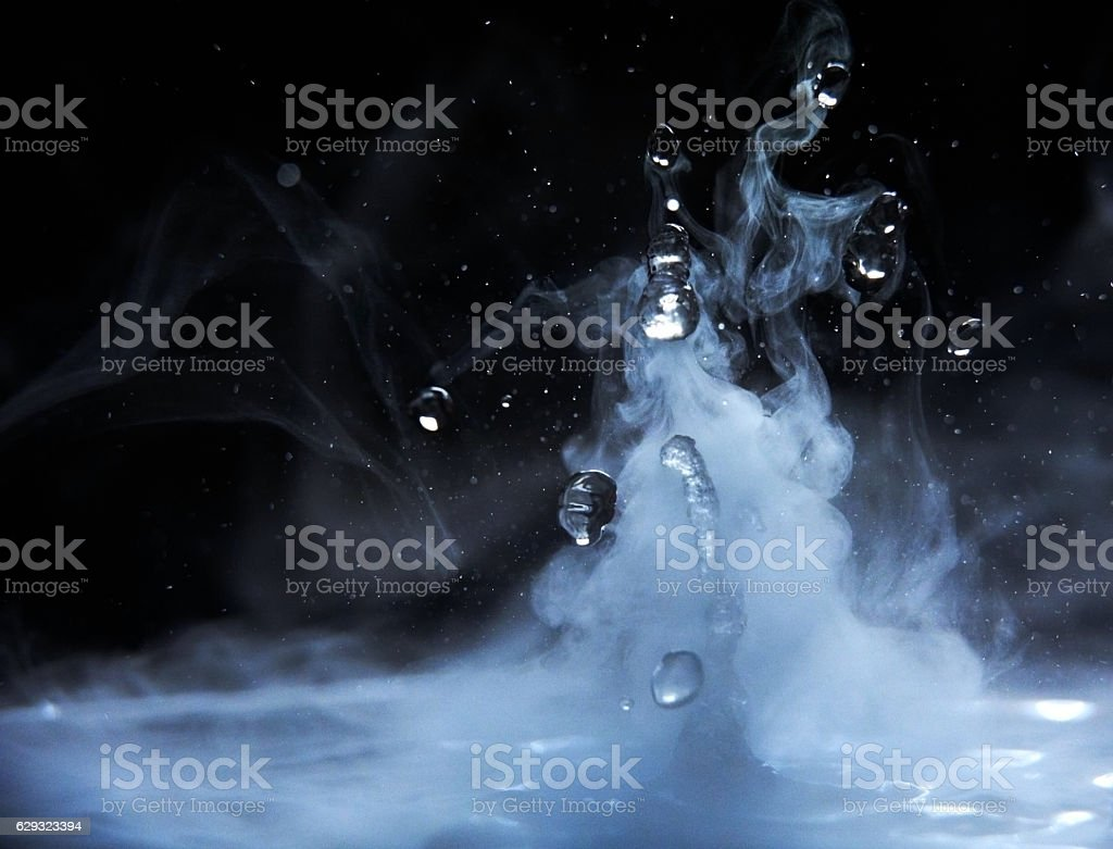splashes of hot water stock photo