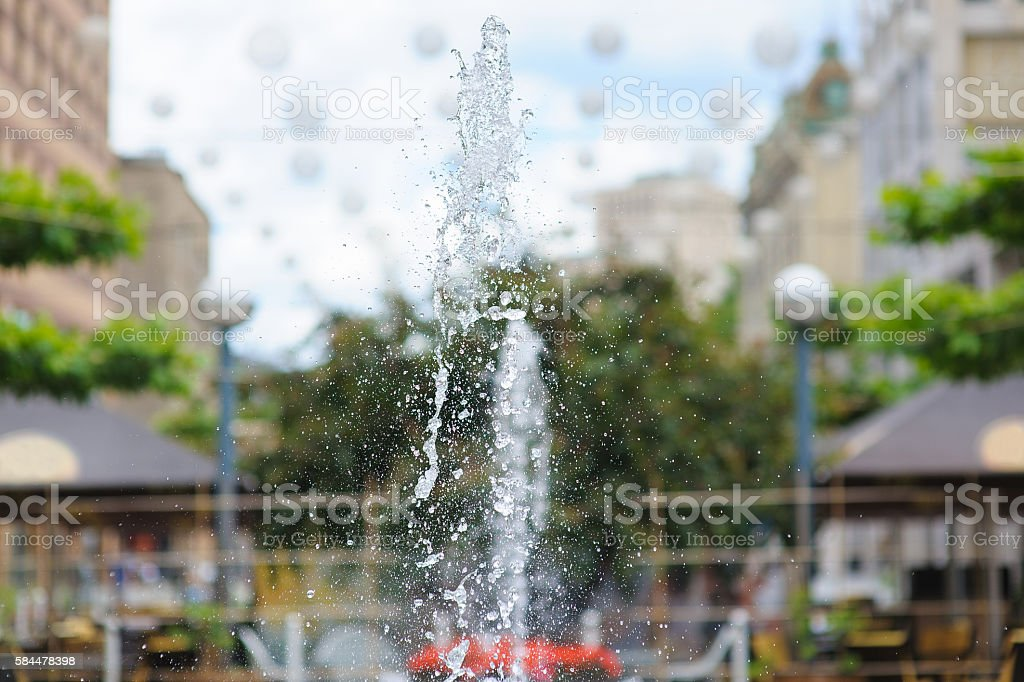 Splashes of water in city fountain stock photo