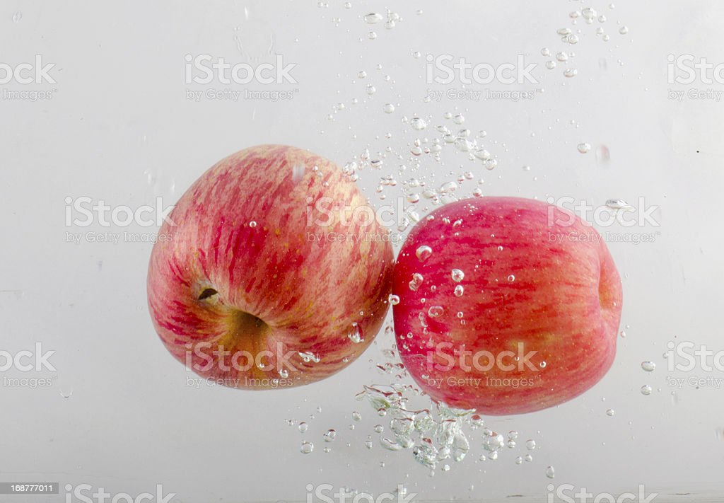 Splashing Apples in Water royalty-free stock photo