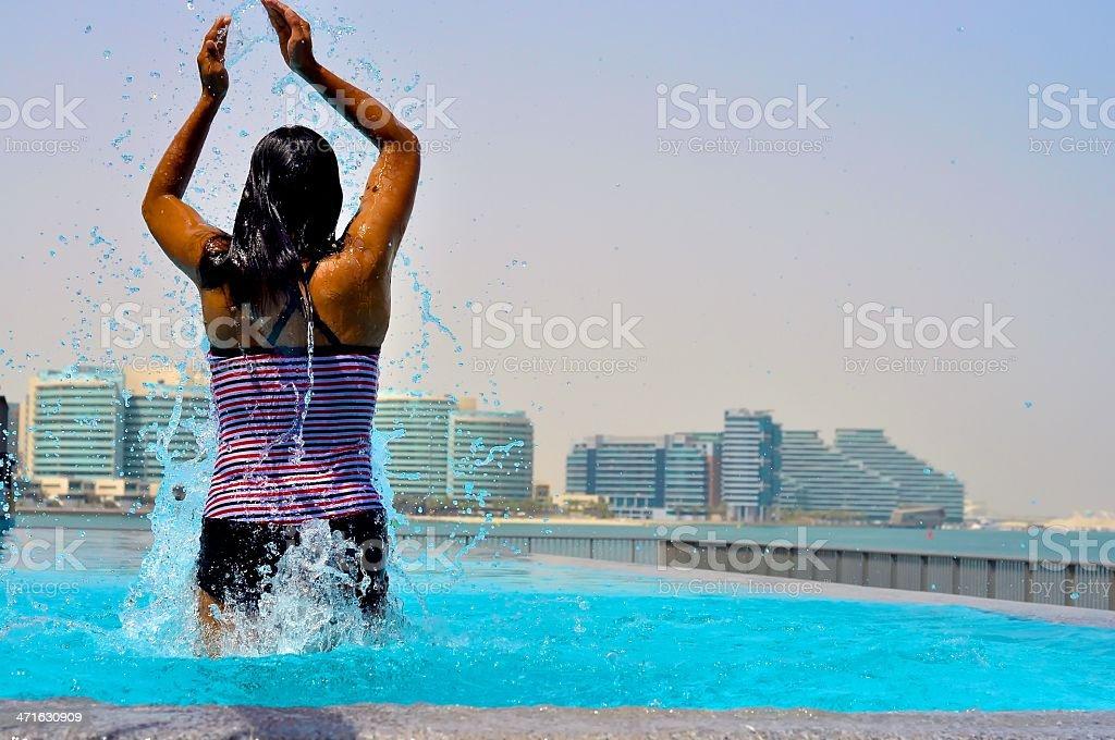 Splashing around infinity pool in Abu Dhabi royalty-free stock photo