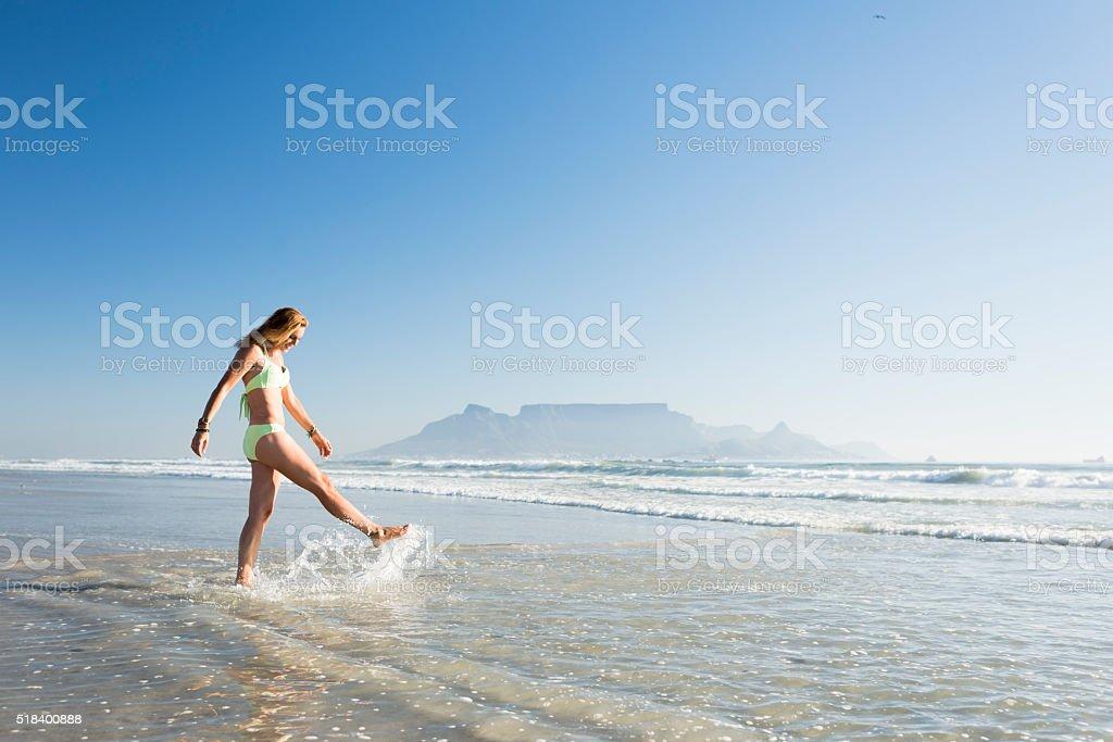 Splashing Around On The Shoreline stock photo