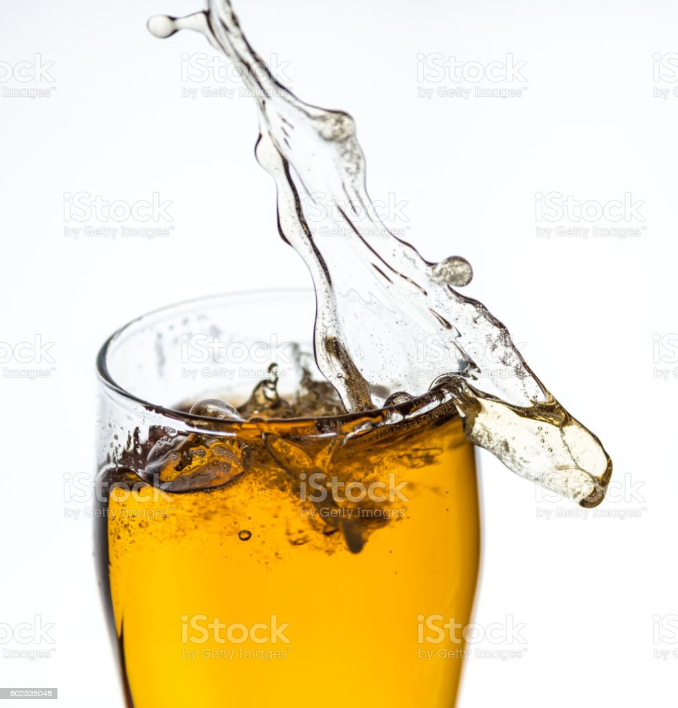 Splashing beer from a glass stock photo