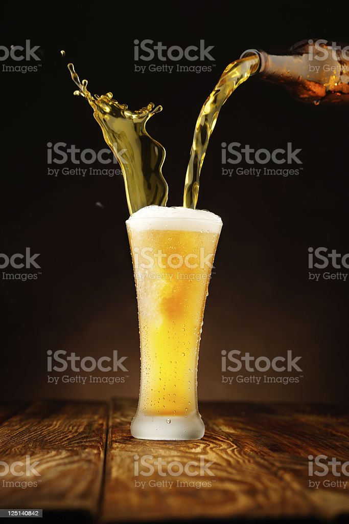 Splashing - Beer pour in glass royalty-free stock photo