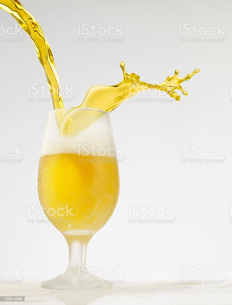 Splashing - Beer pour in glass stock photo