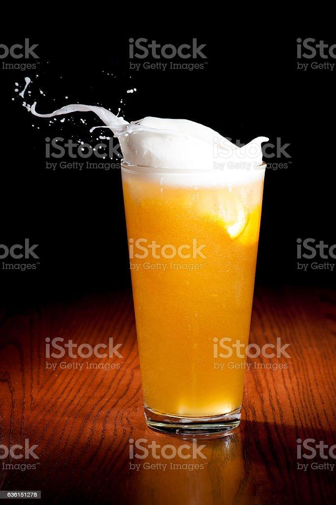 Splashing beer with citrus and orange stock photo