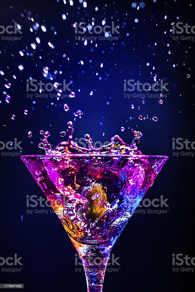 Splashing cocktail rich in colors  stock photo