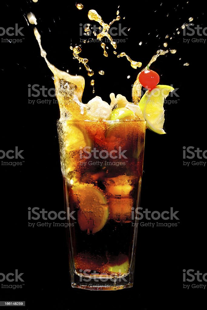 Splashing Cuba Libre Cocktail royalty-free stock photo