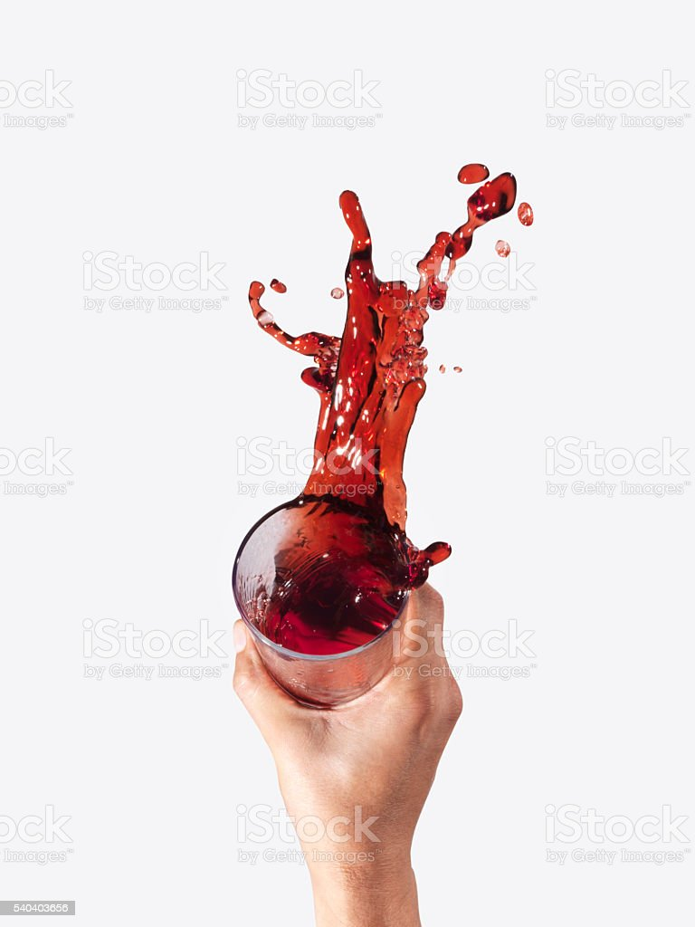 splashing drink stock photo