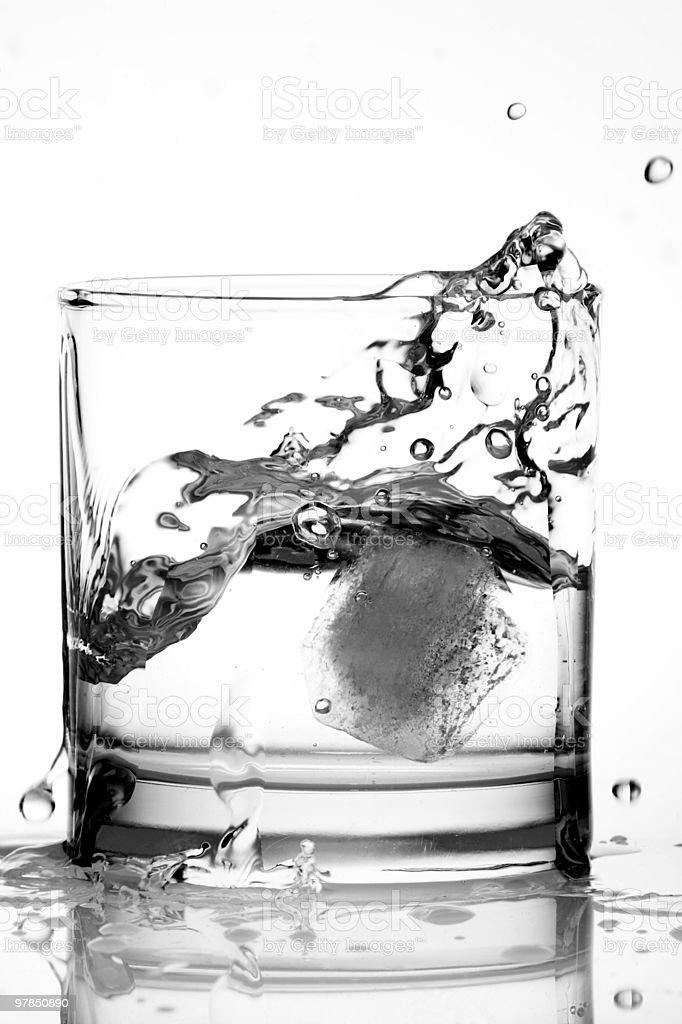 Splashing Ice in a Glass of Vodka royalty-free stock photo
