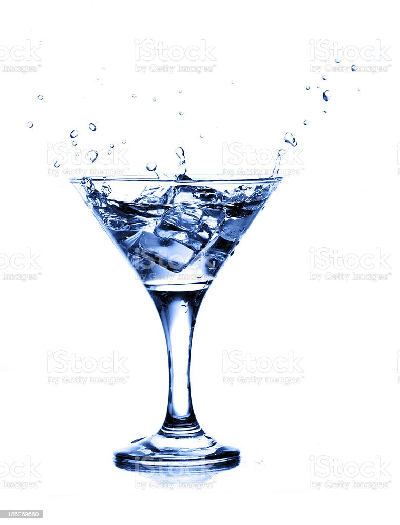 splashing into a martini isolated on white background royalty-free stock photo