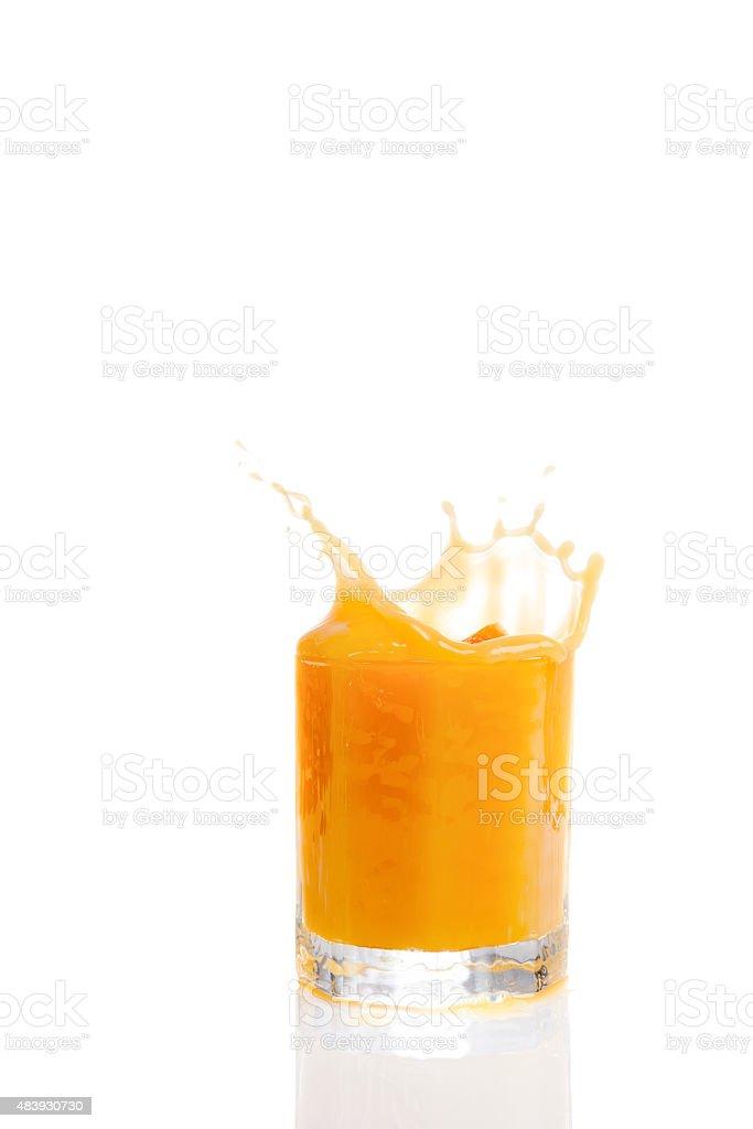 Splashing orange juice against white background stock photo