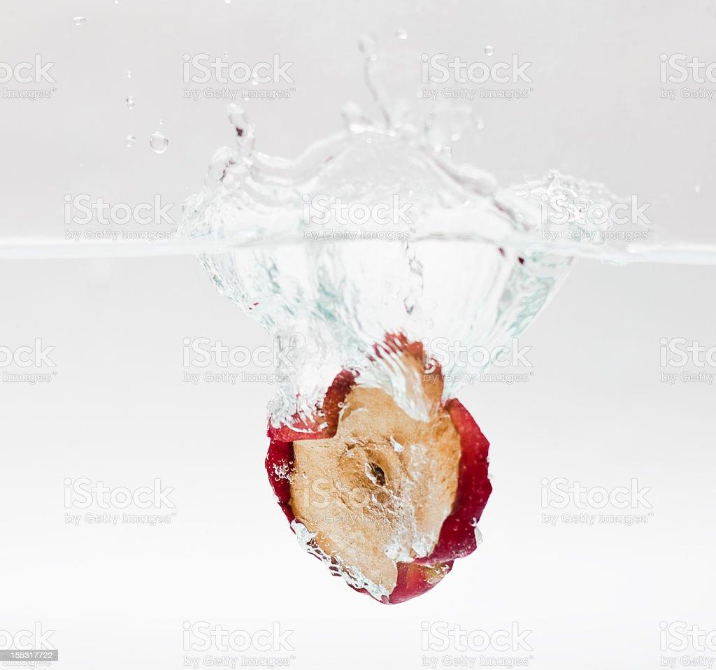 Splashing Slice of apple royalty-free stock photo