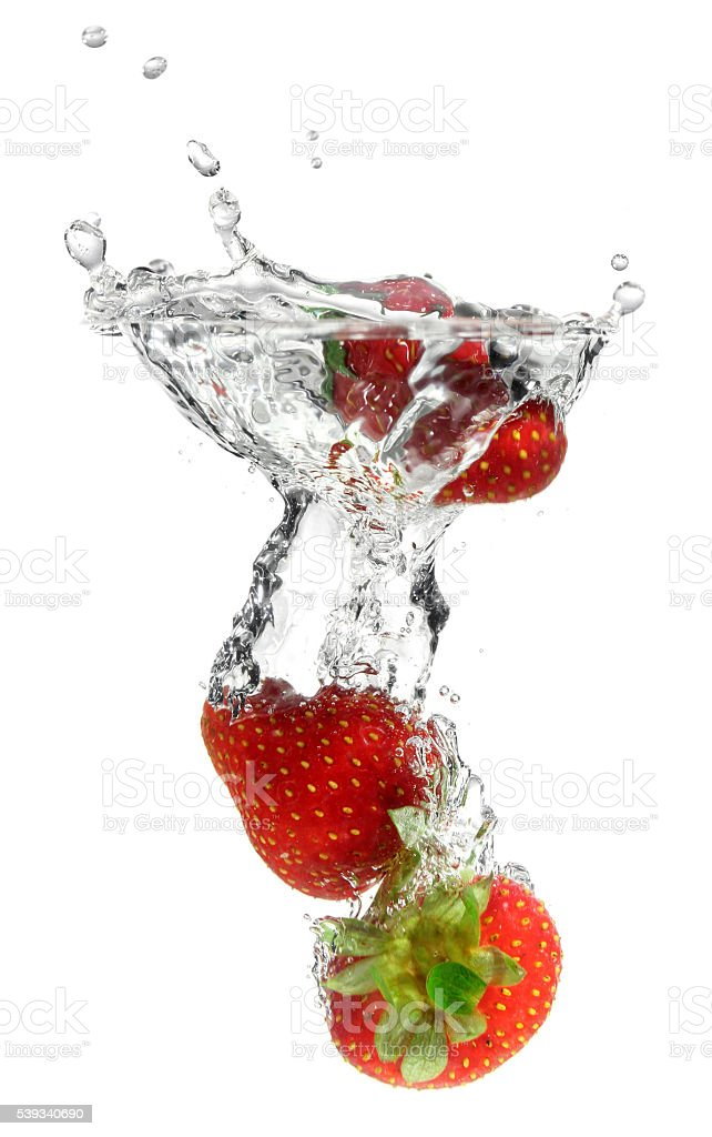 Splashing Strawberry into Water stock photo
