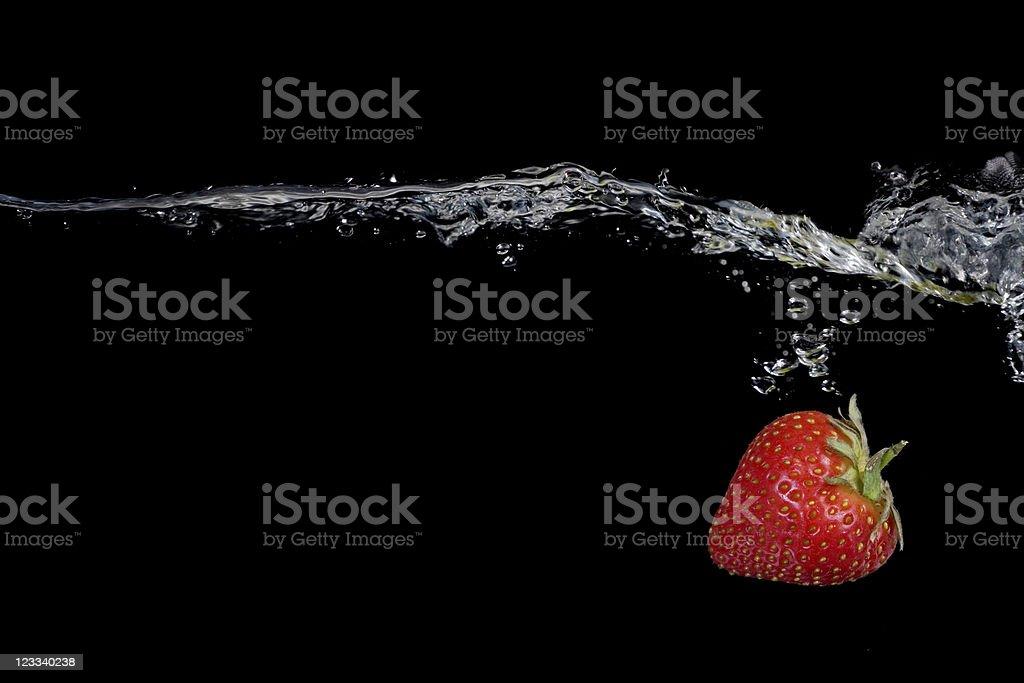 Splashing Strawberry royalty-free stock photo