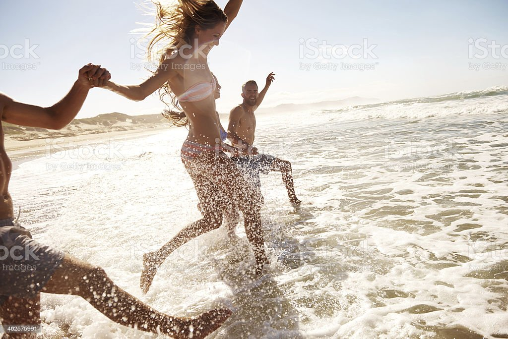 Splashing through the waves stock photo