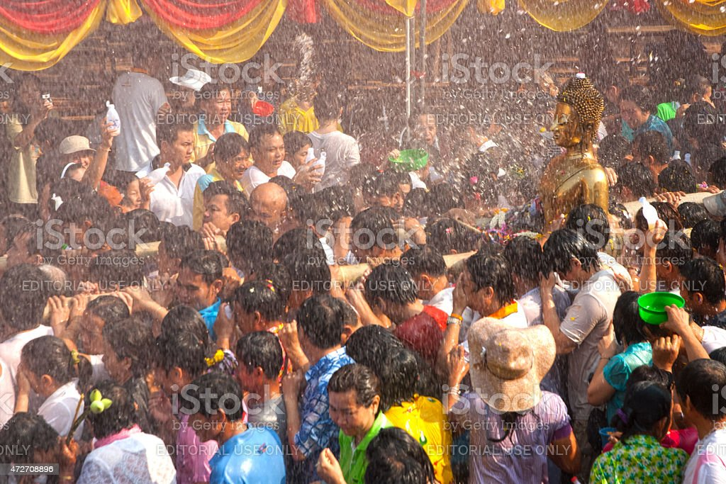 Splashing water of bathing Buddha in Songkran Festival,Thailand. stock photo