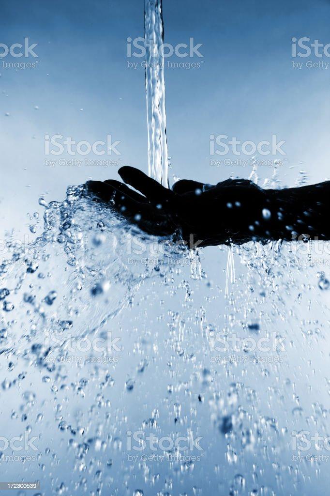 Splashing Water on Hand royalty-free stock photo