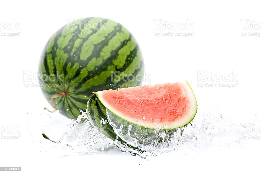 splashing water on piece of melon royalty-free stock photo
