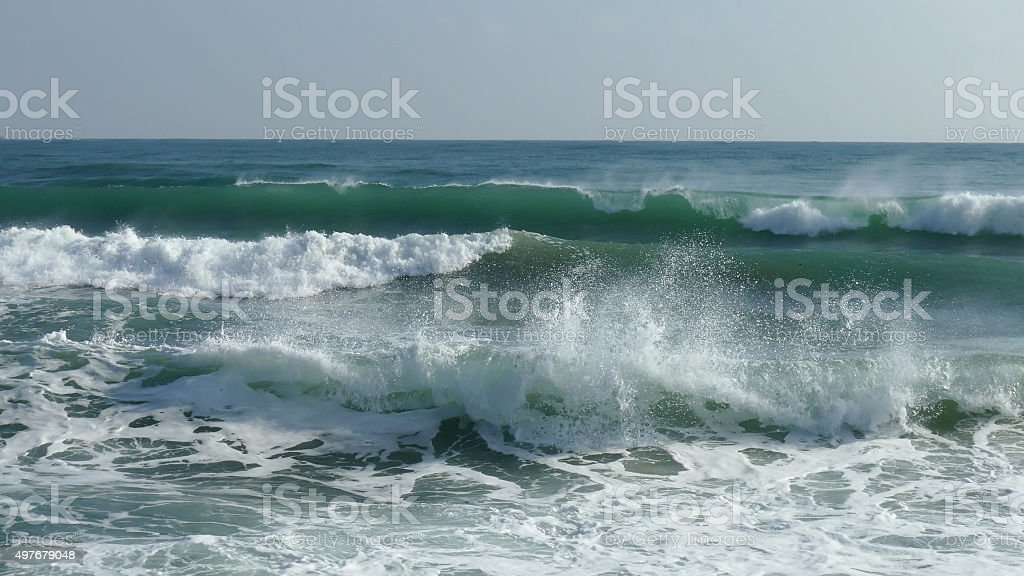 Splashing waves in the sea and clear sky stock photo