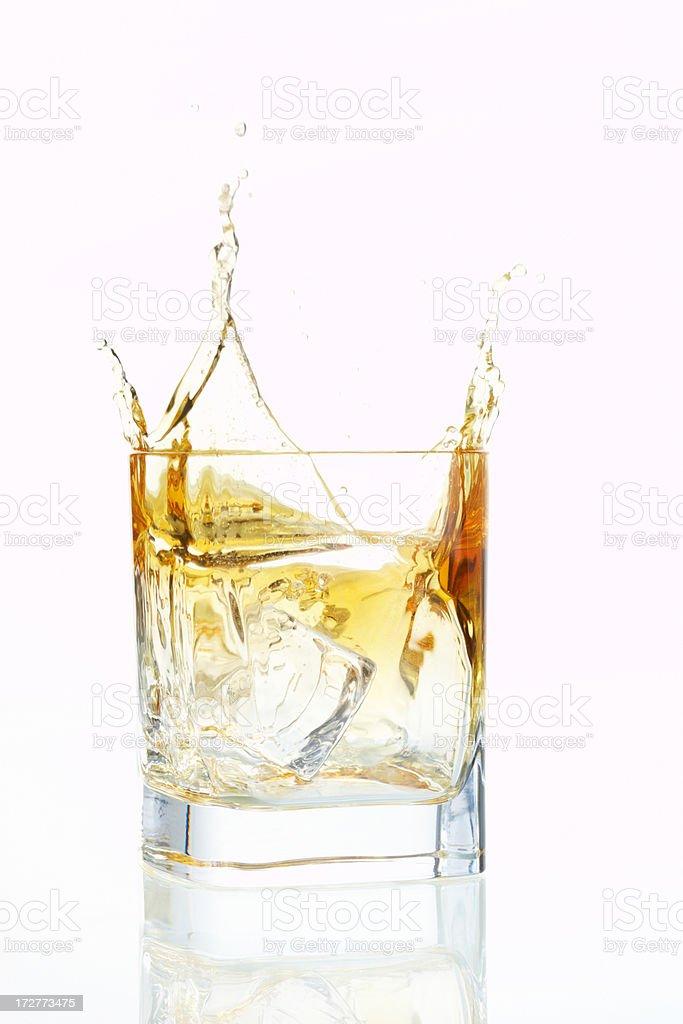 splashing whiskey royalty-free stock photo