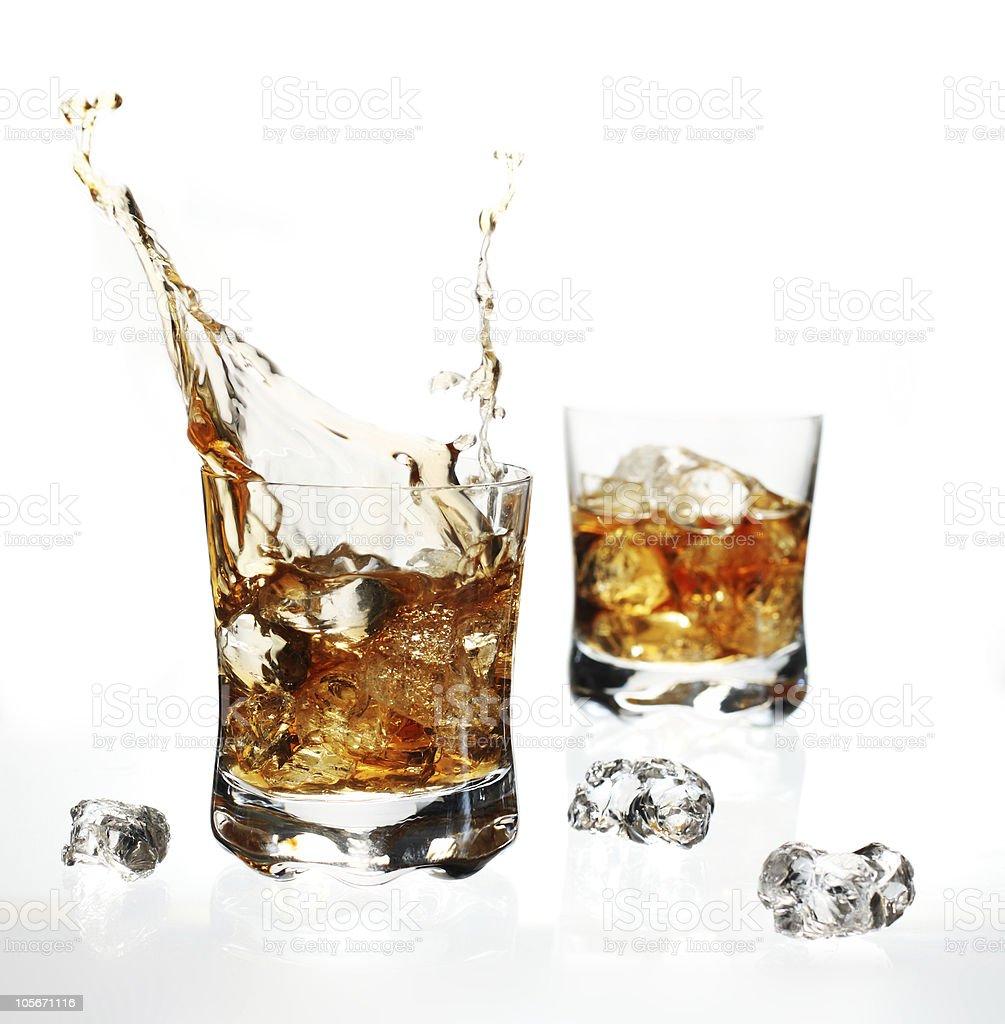 Splashing whisky royalty-free stock photo