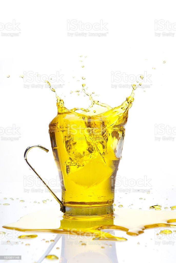Splashing yellow water stock photo