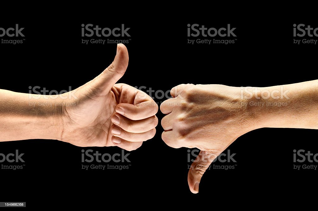 Split Decision; Thumbs-Up, Thumbs-Down stock photo