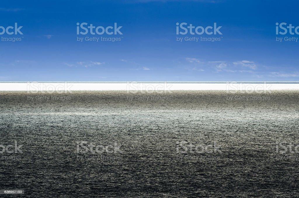 Split dramatic blue horizon on the sea. stock photo