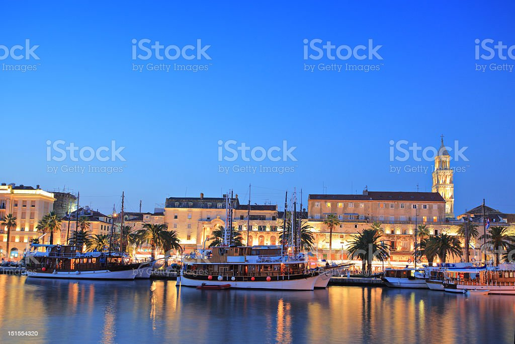 Split harbour depicting Diocletian's palace, by night stock photo
