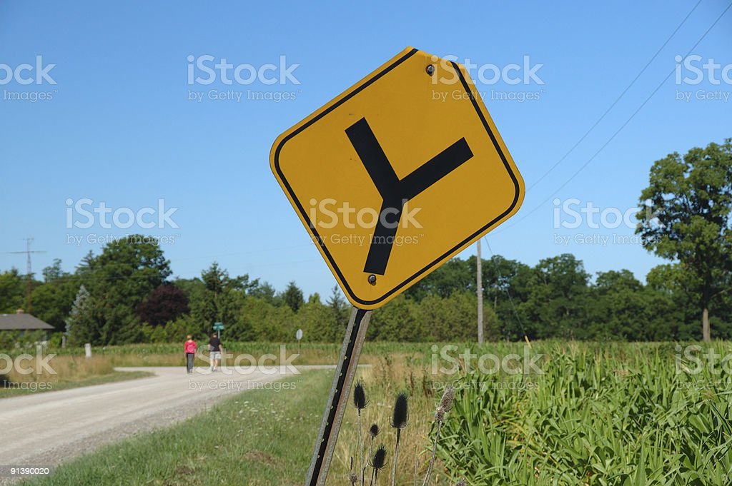 Split in the road - roadsign stock photo
