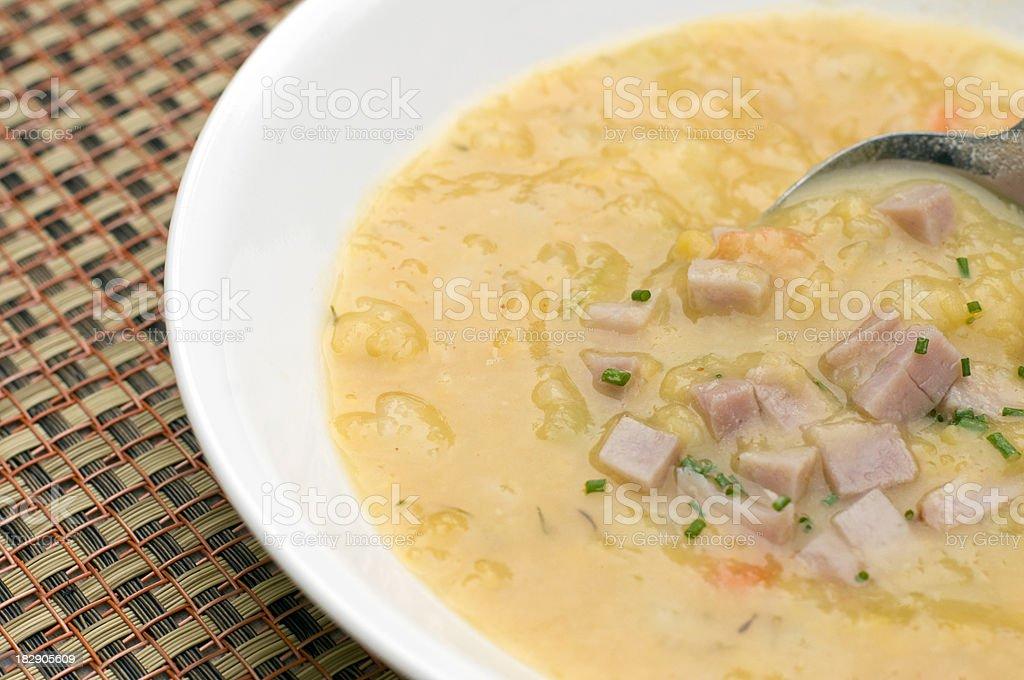Split pea soup, bowl and spoon stock photo