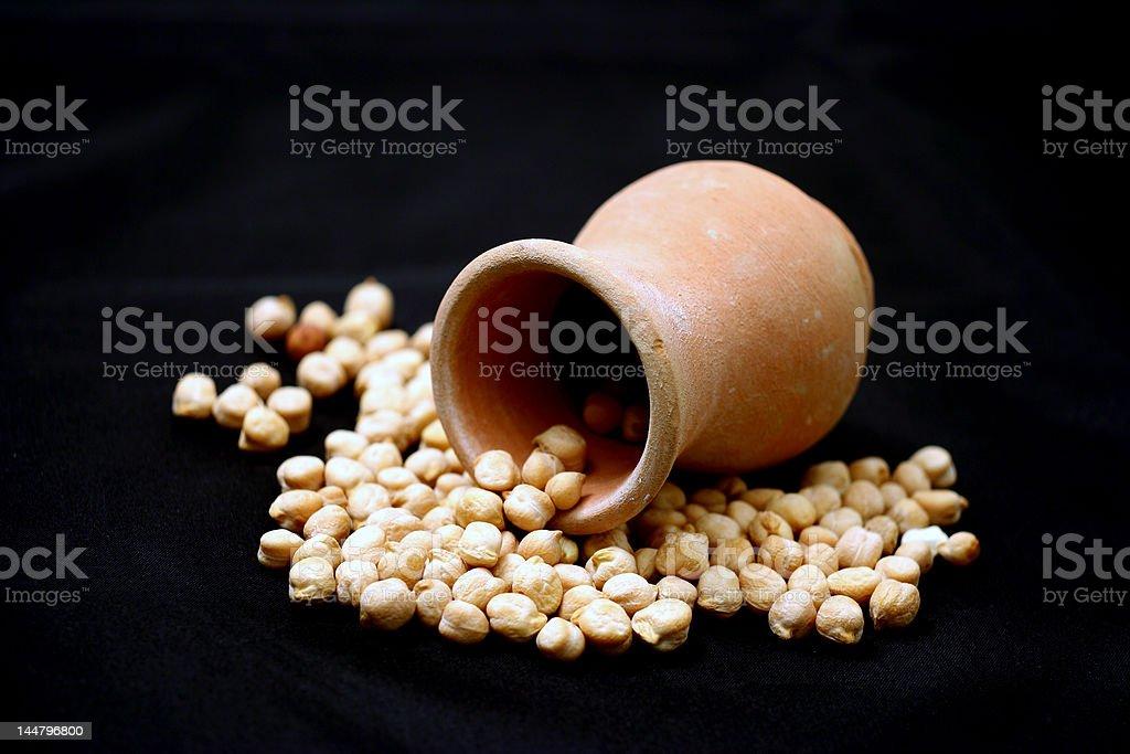 split peas at terracotta jug royalty-free stock photo