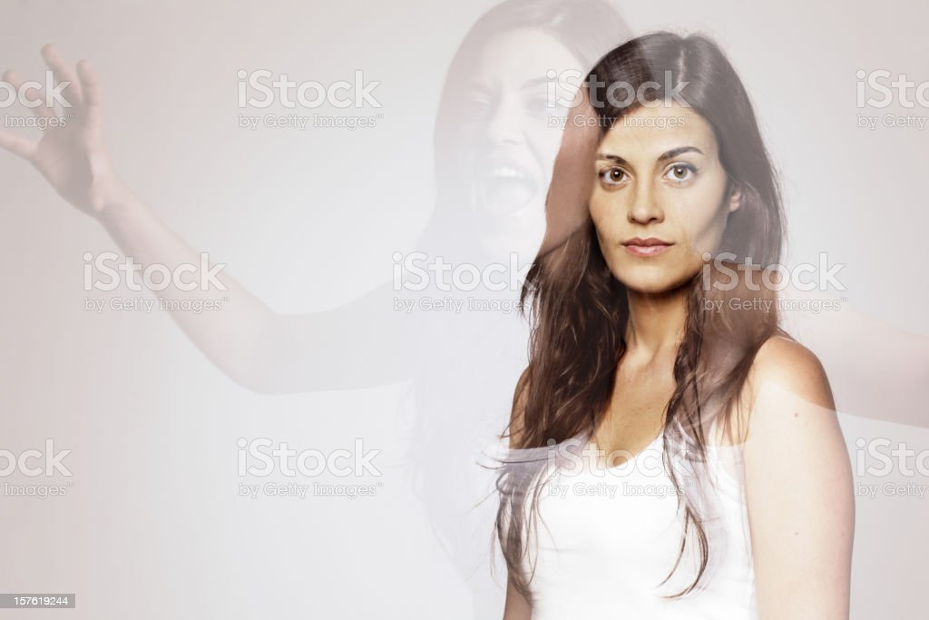 Split personality young woman royalty-free stock photo