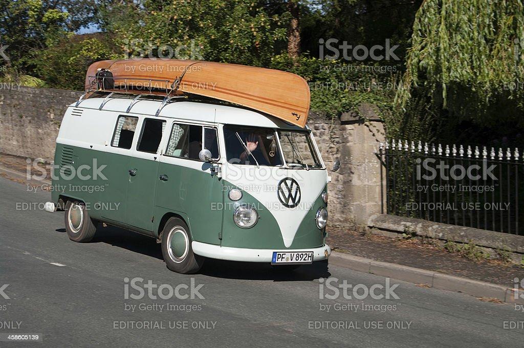VW Split Screen Camper Van with canoe on tour royalty-free stock photo