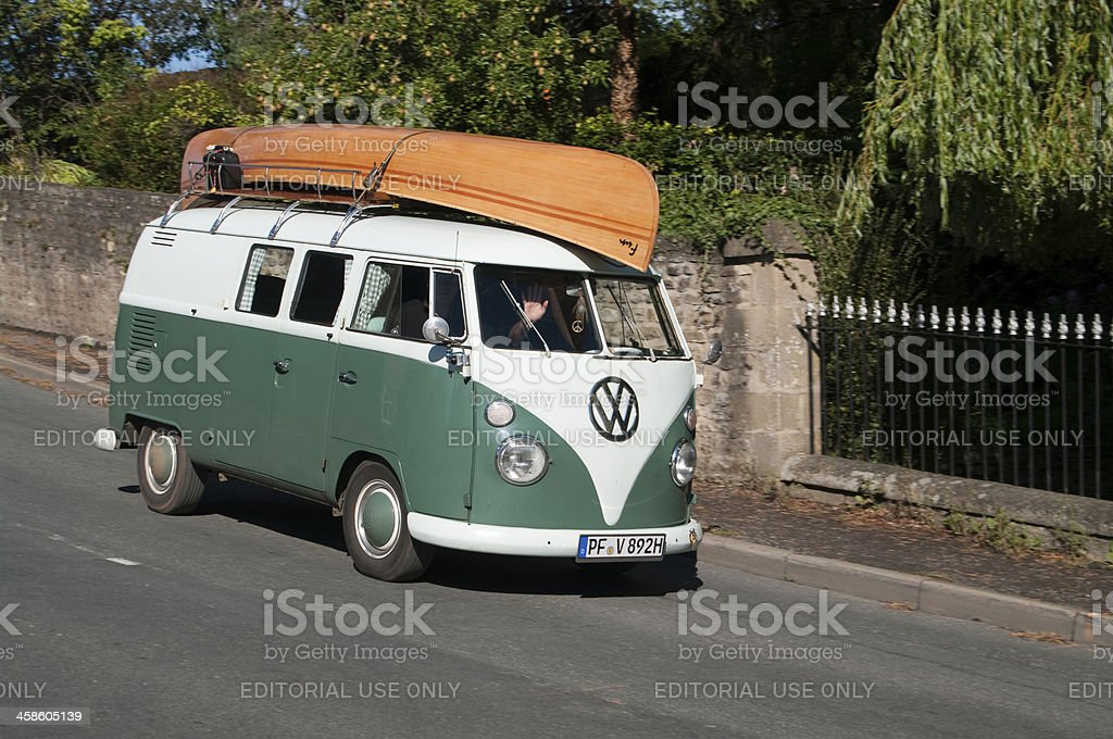 VW Split Screen Camper Van with canoe on tour stock photo