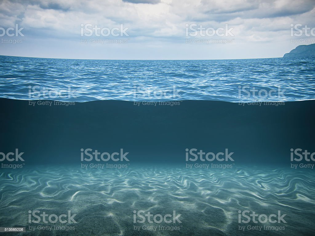 Split Shot Of The Deep Blue Sea stock photo