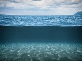 Split Shot Of The Deep Blue Sea