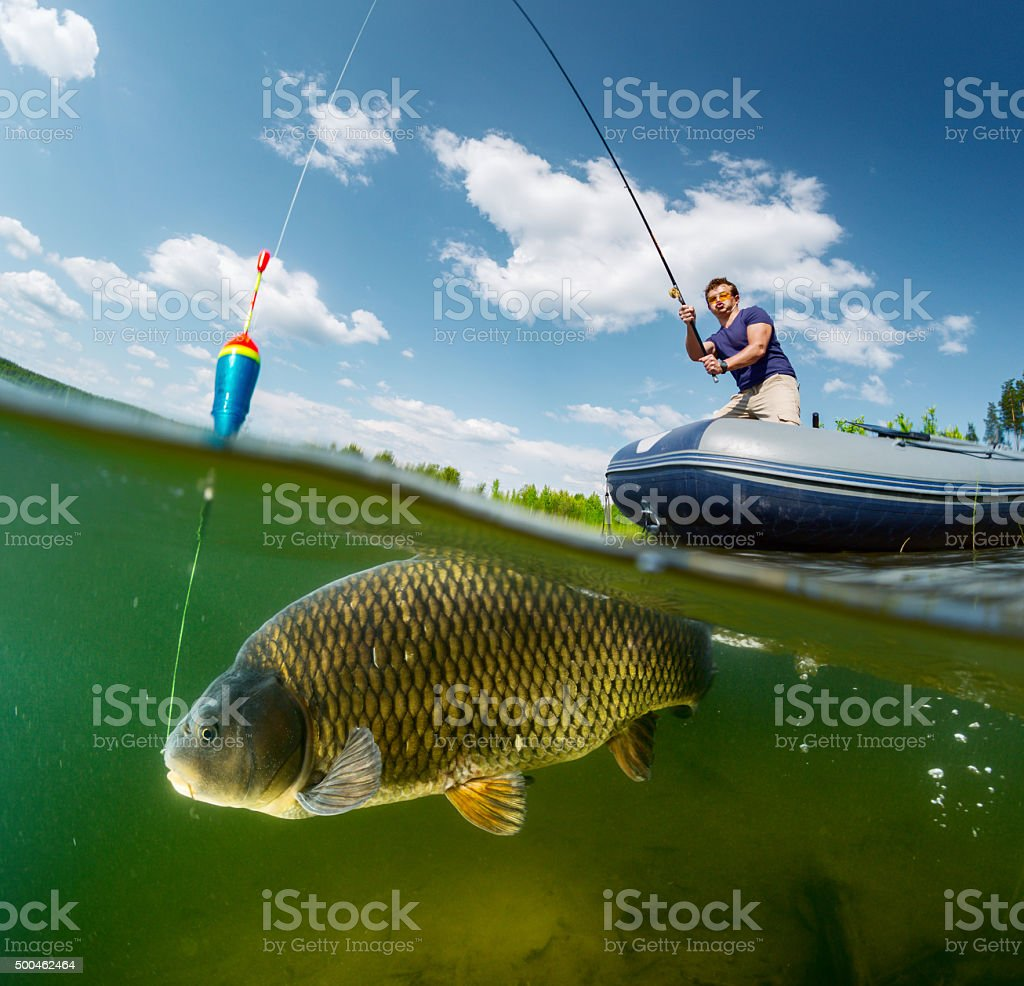 Split shot of the fisherman stock photo