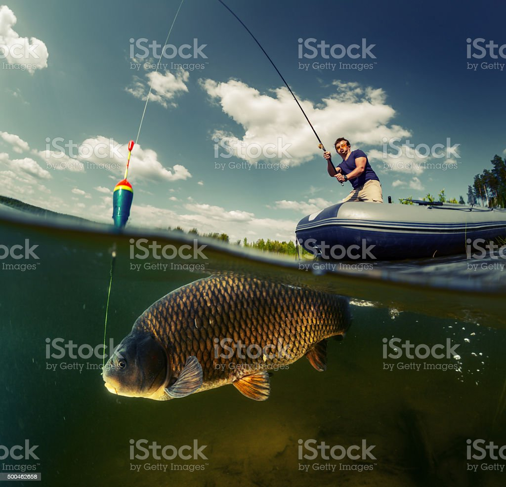 Split shot of the fisherman stock photo