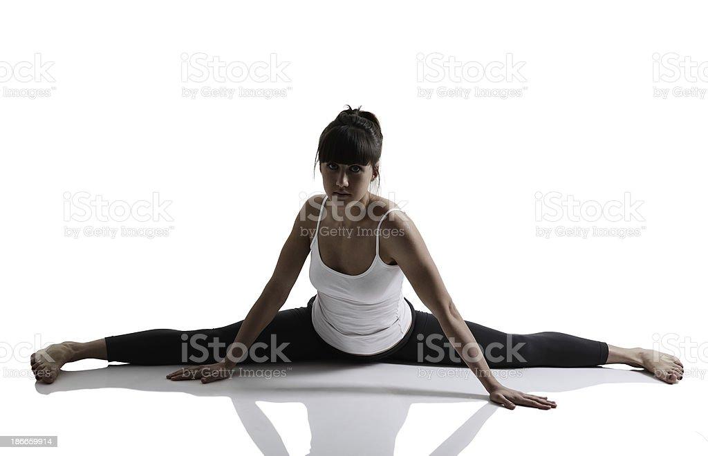 splits, portrait of sport girl doing yoga stretching exercise royalty-free stock photo