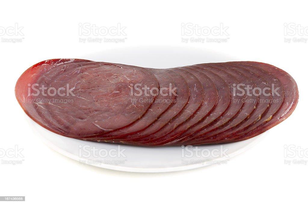Splitting of the reindeer sausage stock photo