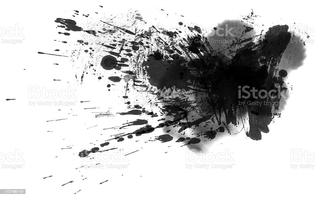 Splotches of black paint splattered on white paper stock photo