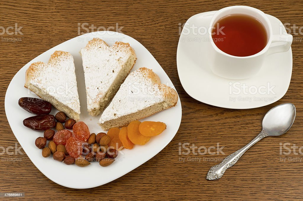 Sponge cake and dried fruit on a plate royalty-free stock photo